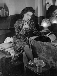 Budding author Lesley Osmond writing backstage during a break from dancing in 'Revedeville' at the Windmill Theatre. The girls dance for 6 hours then sleep on the floor of their dressing room as they eat sleep and work at the theatre, 19th October 1940. Original Publication : Picture Post - 316 - Backstage - pub. 1940. (Photo by Picture Post/Hulton Archive/Getty Images)