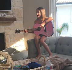 Sierrah playing with guitar she got for her birthday