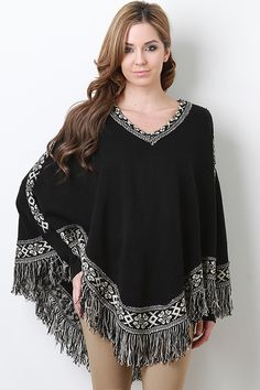 Keep yourself cozy with the Finest Tribe Top. This poncho features soft woven knit, contrasting tribal print paneling throughout, round neckline, long batwing sleeves, and finished with asymmetrical fringe hem.