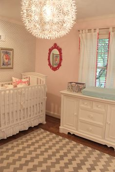 soft and feminine girls room - chevron rug, silver leaf polka dot wallpaper and blush colored walls.