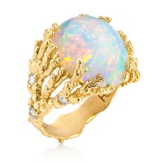 "Ornella Iannuzzi ""Coral Atoll"" ring with an Ethiopian Wello opal, set in gold (£POA)."