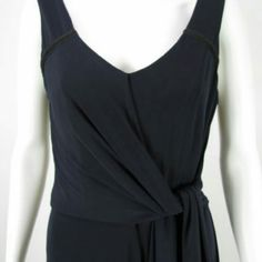 Badgley Belle Mischka Jumpsuit A gorgeous jersey soft jumpsuit from Belle Badgley Mischka. Features V-neckline, concealed back zipper closure, attached self tie belt, wide flowy legs, lined bodice. Shell 95% Polyester, 5% Spandex. Lining 92% Polyester, 8% Spandex. Belle Badgley Mischka Pants Jumpsuits & Rompers