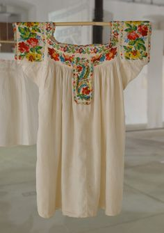 https://flic.kr/p/4vXQYq | Mexican Beaded Blouse Oaxaca Costa | This beaded blouse was Part of the Arte Textil exhibit in San Agustin Etla Oaxaca. The blouse may have been made on the coast of Oaxaca, possibly in Tututepec.  I was able to buy a copy of the new book El Ropero de Frida while in Oaxaca. In one of the many photos of her included in this terrific book, she is wearing a blouse much like this one. She certainly had great taste in clothing