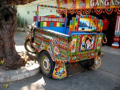 A converted motor-cyle rickshaw. Intricately painted. In the tiny state of Diu, in Gujarat, India.    Old Delhi used to have Harley Davidsons converted into people carriers, but they were rather plain in comparison.         www.travellers-palm.com