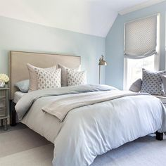 This gorgeous guest bedroom has been affordably decorated using a variety of do-it-yourself skills. An upholstered headboard with nailhead trim tops off the bed and creates the perfect focal point, while cushions and Austrian blinds add colour, pattern and texture to the room. - See more at: http://www.home-dzine.co.za/crafts/craft-sewing-skills.html#sthash.7k3s0wx0.dpuf