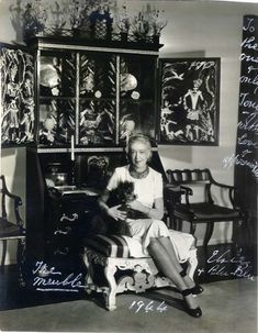 Elsie de Wolfe seated in front of her Tony Duquette secretary, in her house, After All, in Hollywood, circa 1944.