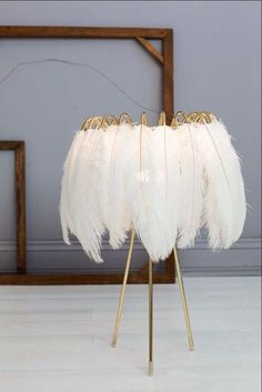 These glamorous feather lamps designed by Young and Battaglia feature luxurious black or white feathers Soft and delicate these beautiful feathers