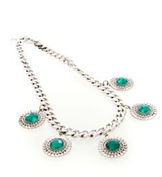 Embedded faux emerald stones set to sparkle against your outfit. Perfect against black or white