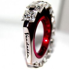 """VENDETTA RING COLLECTION 750 GOLD, PRINCESS-CUT DIAMONDS, CORUNDUM. This tribute to Shakespeare's """"Romeo and Juliet"""" has been designed to be worn on the little finger."""