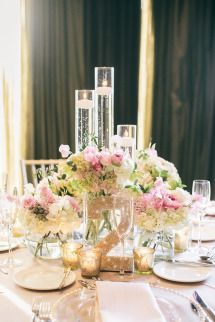 low arrangements with candles in cylinders