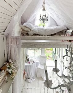 tiny house interior (small space, lots of style) I love all the white and the chandeliers....just not the frills. love the cozy loft bedroom