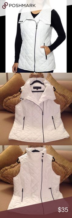 """🍃🌹Marc New York - Andrew Marc Vest🍃 Pure White Vest by Andrew Marc. Size XL. High Neck collar, two front pockets that zips. It has a Side 'Front' Zipper. Made of 100% Polyester. Measures:  23"""" inches from Armpit to Armpit. And 29"""" from Shoulder to Hemline. (Slight flair at the bottom). New and Excellent Condition!!🍃🌹 Andrew Marc Jackets & Coats Vests"""
