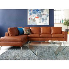 Kasala - Modern style leather or fabric sectional, sofa, and ottoman collection