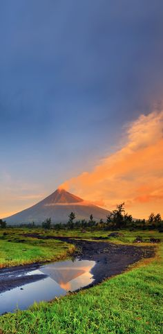 The Mayon Volcano Natural Park is a protected area of the Philippines located in the Bicol Region on southeast Luzon Island, the largest island of the country. The Natural park covers an area of 14,272 acres, which includes its centerpiece Mayon Volcano, the most active volcano in the Philippines, and its adjacent surroundings. The volcano is also renowned for having an almost perfect cone. First protected as a National Park in 1938, it was reclassified as a Natural Park in the year 2000.