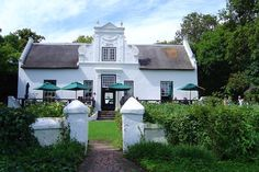 The renowned Zevenwacht wine estate will be your home for the first three nights of this African adventure. Beautiful Homes, Beautiful Places, Cape Dutch, Dutch House, Dutch Colonial, Colonial Architecture, Adventure Is Out There, Traditional House, South Africa