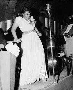Ella Fitzgerald- http://www.youtube.com/watch?v=UY8zK4R9oE8