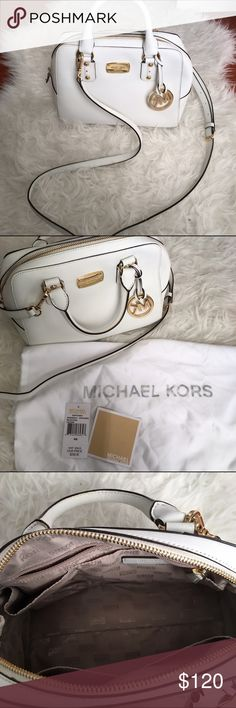 """Michael Kors Mini Saffiano Leather White Satchel 100% Authentic Michael Kors Satchel in White. Comes with dust bag and tags. Been worn only one time. There are stains from my jean in the back of the bag shown on last picture. You can buy leather cleanser to clean that off. Eveything else is in excellent condition. Measurements: 8""""L x 6""""H x 3""""W Michael Kors Bags Crossbody Bags"""