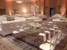 Glass table & Plexi chairs with Chrystal chandelier centerpiece. Orchids