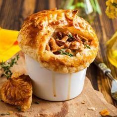 Coffee Mug Chicken Pot Pies with Mushrooms Recipe Main Dishes with cream of chicken soup, milk, dried thyme, chicken, frozen vegetables, mushrooms, biscuits