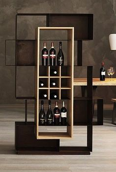 """Mooie, an iron bottle rack and bookcase, has a double nature. Used by wine lovers to display their excellent wines in a suitable rack, it can also become a cradle of knowledge for the house by storing a personal collection of books"" - NICE VICE - (""Mooie"" bookcase / bottle rack from Elite to Be)"