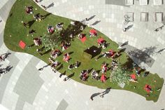 The international company unfolds a grassy lawn to give a monochromatic city a splash of color.