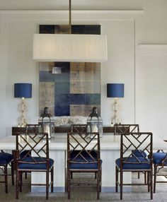 Navy chairs in dining room.