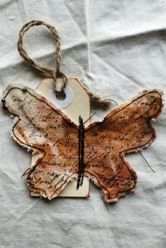 Create a stamped & sewn fabric butterfly to use as an embelishment on cards or scrapbooking pages etc