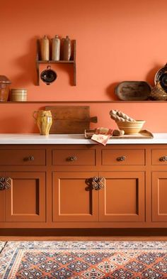Find your favourite orange paint shade from our collection. From peach tones to darker terracotta, orange has a broad appeal suitable for most rooms in your home. Kitchen Cabinets Orange, Orange Kitchen Walls, Orange Kitchen Decor, Paint For Kitchen Walls, Painting Kitchen Cabinets, Kitchen Colors, Kitchen Design, Orange Kitchen Interior, Burnt Orange Kitchen