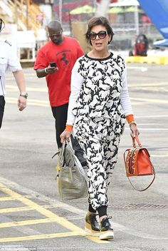 Trot along:Kris Jenner near galloped her way into Manhattan on Friday with boyfriend Corey Gamble in tow