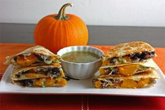 Pumpkin Quesadillas ~ pressed tortillas with a filling of pumpkin, peppers, black beans, scallions, & cheddar | from Closet Cooking