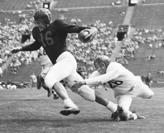 Frank Gifford freeing himself from tackling Johnny Williams in the final spring practice game, University of Southern California by Unknown