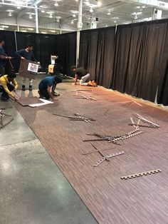 Faux woods mats being set up for a trade show. Faux Wood Flooring, Basement Flooring, Flooring Ideas, Trade Show Flooring, Mat Exercises, Playrooms, Booth Ideas, At Home Gym, Floor Mats