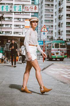 Beige sweater+white denim skirt+cognac ankle boots+cognac belt+white chain shoulder bag+beige baker-boy cap+gold necklaces+gold earrings. Fall Casual Outfit 2017