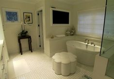 Style Network: Giuliana and Bill Rancic - Gorgeous master bathroom with modern freestanding tub and ...