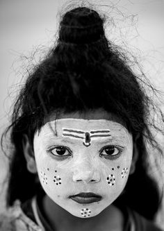 Young Girl With Shiva Make Up, Maha Kumbh Mela, Allahabad, India, by Eric Lafforgue via Flickr.