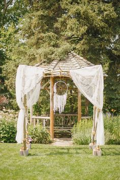 What a dreamy boho forest ceremony! Love the dreamcatcher.  View the full wedding here: http://thedailywedding.com/2015/11/22/dreamy-forest-wedding-emily-michael/