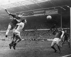 11 April 1970: Peter Osgood of Chelsea beats the Leeds United footballer Terry Cooper to the ball during the FA Cup final...
