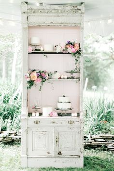 Dessert table and display for a wedding cake at a pink and lavender wedding. See more from this real wedding on Aisle Planner!