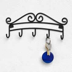 """Amazon.com: Key Rack - Scroll (Black) (3.75""""H x 9.5""""W x 1.1""""D). $7.21, Prime Eligible. Also available in Silver. Bed Bath & Beyond has a similar one."""