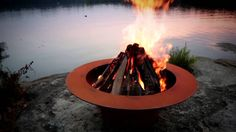 The Saturn Fire Pit reminds us of its name sake planet Saturn with the spectacular ring feature in the night sky. The fire pit ring is a convenient resting s. Fire Pit Art, Fire Pit Ring, Fire Pits, Heartland Of America, Steel Fire Pit, Thing 1, Outside Patio, Fire Pit Designs, Steel Art