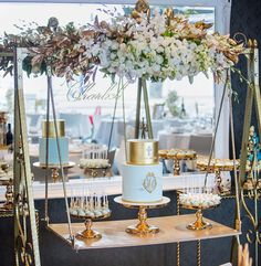 A beautiful cake display with gold cake swing, rope gold table and gold stands. Wedding Desserts, Wedding Cakes, Wedding Decorations, Cake Table Birthday, 60th Birthday, Wedding Cake Display, Wooden Cake, Gold Cake, Candy Table