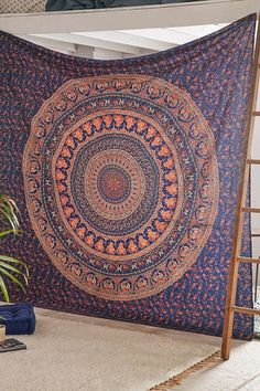 Mesmerizing medallion tapestry crafted in soft woven cotton. Instantly adds a unique touch of boho charm to any living space or dorm room. Doubles as a