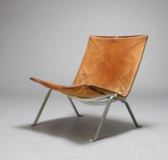The PK22, designed by Poul Kjaerholm (Denmark 1929-1980). Materials: leather and polished metal. From the late fifties to the early seventies, Poul Kjaerholms furniture was produced by E. Kold Christensen in Denmark. Fritz Hansen took over production in the late 1970s and continues to produce some models to the present day.