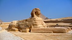 Part I. The Great Sphinx at Giza. It is a part of the funerary complex of Khufu (Cheops) (reign 2589-2566 BC) The Great Sphinx is carved from a solid block of limestone outcropping; the figure is a crouching lion with a human head, a representation of  Re-Harakhte, the sun god, at dawn at the rising in the east.