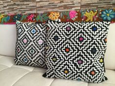**KENÉ**  These beautiful pillow covers have been embroidered on both sides. We have used Alpaca yarns and cotton threads. The fabric has hand-woven in a homespun, hand-dyed wool yarn.  These pillows were inspired for the geometric designs of the Shipibo-Konibo Art, called Kené.  ONE OF A KIND PIECE  15.7 (40cm) Square Front and back: 50% Wool, 50% Alpaca Backing: 100% Cotton Only cushion cover  These pillow covers were hand embroidered by Quechua women from Ayacucho, South-Central Peruvian…