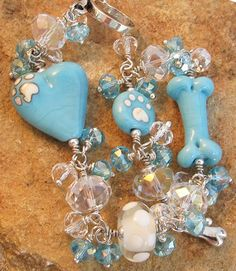 Aqua Blue Bling Bracelet Dog Bone Heart Paw Print Artisan Lampwork.  Adorable silver dog collar and dog bone toggle clasp.  Handmade dog lover bling from For Love of a Dog.