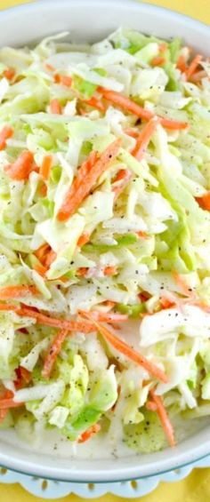 """KFC-Coleslaw-Recipe. This is an amazing copycat version of the famous KFC Coleslaw Recipe. It's sweet, a little tangy and fabulously creamy! My all-time favorite coleslaw recipe!"""