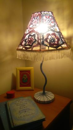 The lamp is unique and one of a kind. The lampshade is made of lacy hand-crocheted patterns, sewn to the frame. The colors, and forms carefully assorted to create an effect of vintage charm and Innocence, while the stand and base lend the product a more quirky and modern feel.   For more info or to buy go to the link below