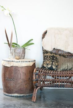 Interior Vignette - cane chair paired with a drum to act as a sidetable #tribal #african