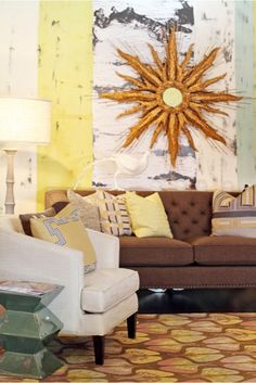 This Living Rooms has a cozy feeling because of the warm colors of yellow and orange.